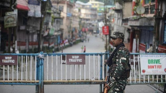 Paramilitary forces stand guard along a road during a strike called by the Gorkha Janmukti Morcha for separate state Gorkhaland in Kalimpong on September 3, 2017.(AFP File Photo)
