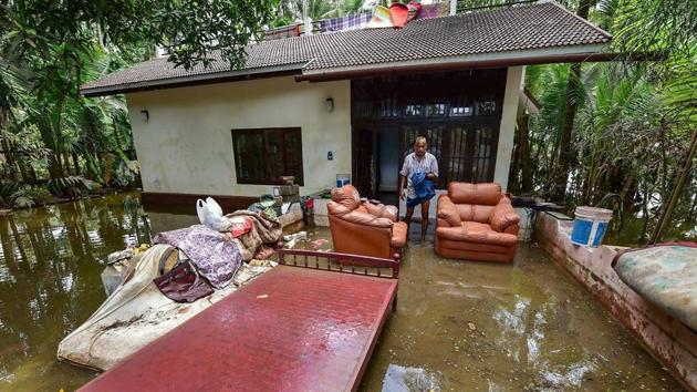 A man cleans up his house after flood water subsided, in Puthenvelikkara near Kochi on Wednesday, Aug 22, 2018.(PTI)