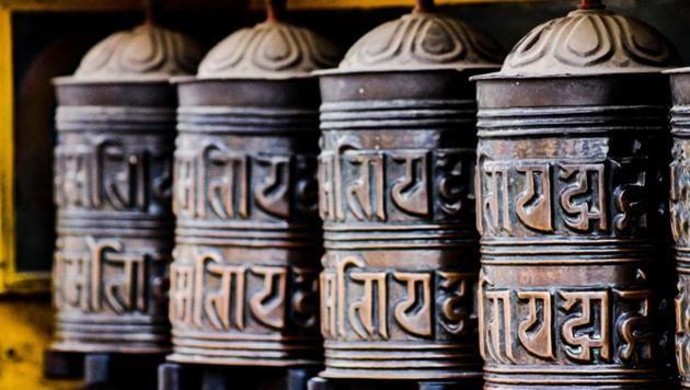 A Tibetan prayer wheel in Swayambunath Temple. The text written in each wheel is in Sanskrit.(Shutterstock)
