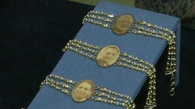 The jewellery shop in Gujarat textiles and diamond polishing in Surat has upped the style quotient by selling rakhis made of gold with profile pictures of Prime Minister Narendra Modi, Yogi Adityanath and Gujarat Chief Minister Vijay Rupani engraved.(ANI)