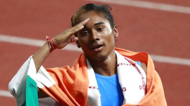 India's Hima Das celebrates after her second place finish in the women's 400m final during the athletics competition at the 18th Asian Games at Gelora Bung Karno Stadium.(AP)
