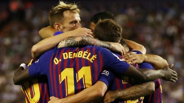 Barcelona's Ousmane Dembele celebrates with team mates after scoring their first goal against Real Valladolid.(REUTERS)