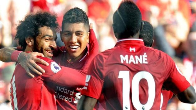 Liverpool's Mohamed Salah celebrates with Roberto Firmino after scoring their first goal.(REUTERS)