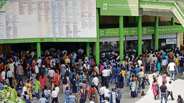 Passengers wait outside HUDA City Centre Metro station. Metro authorities said they were forced to shut down the entry gates at Huda City Centre and Iffco Chowk stations after Sunday morning's snag.(Yogendra Kumar/HT PHOTO)