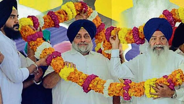 SAD president Sukhbir Singh Badal being garlanded during the political conference at Baba Bakala.(HT Photo)