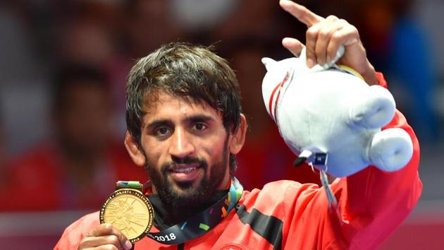 India's Bajrang Punia poses with his gold medal after winning in the Finals of men's freestyle wrestling (65kg) at Asian Games 2018.(PTI)