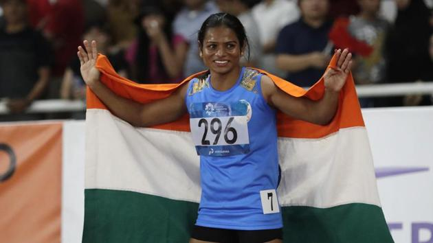 Dutee Chand celebrates after her second place finish in the women's 100m final during the athletics competition at the 18th Asian Games in Jakarta.(AP)