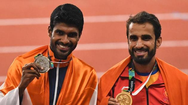 Manjit Singh (right) took the yellow metal in men's 800 metres and was closely followed by Jinson Johnson who won the silver.(AFP)