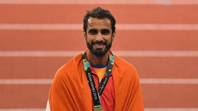 Gold medallist Manjit Singh celebrates during the victory ceremony for the men's 800m athletics event at the 2018 Asian Games in Jakarta on August 28.(AFP Photo)