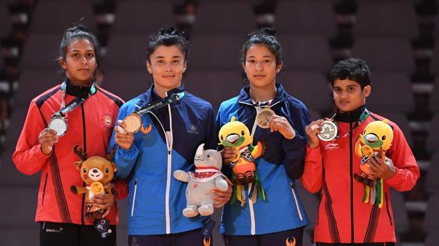Silver medallist India's Pincky Balhara (L) and bronze medallists Uzbekistan's Oysuluv Abdumajidova (2R) and India's Malaprabha Yallapa Jadhav pose during the medal ceremony for the women's -52kg kurash.(AFP)