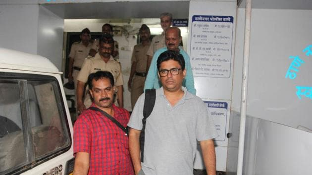 Arun Pereira (in grey), a human rights activist and lawyer, arrested by Pune Police on Tuesday.(Praful Gangurde/HT Photo)