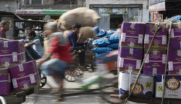 Workers transport goods at Khari Baoli spice market in New Delhi. India is rebounding from an economic slowdown, with growth seen at more than 7 per cent, only to find itself ensnared by the volatility engulfing emerging markets.(Ruhani Kaur/Bloomberg)
