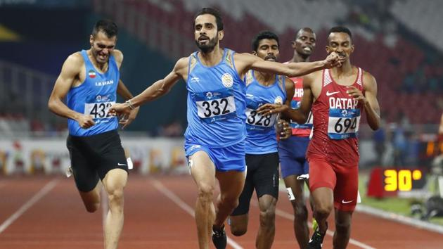 India's Manjit Singh reacts as he crosses the finish line to win the men's 800m final at the 18th Asian Games in Jakarta.(AP)
