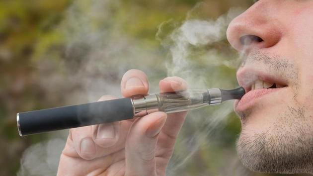 Young smoker is vaping e-cigarette or vaporizer.(Getty Images/iStockphoto)