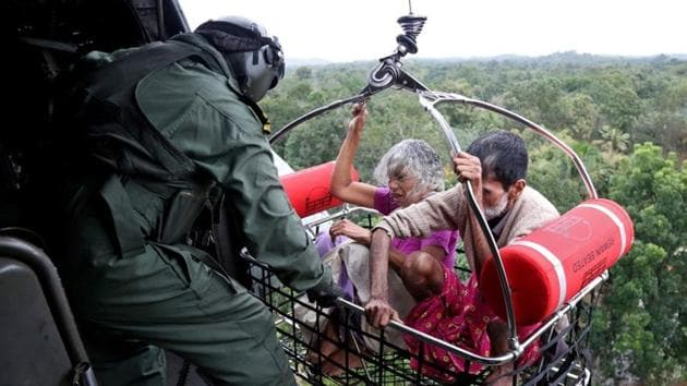 People are airlifted by the Indian Navy soldiers during a rescue operation at a flooded area in Kerala on August 18.(REUTERS)