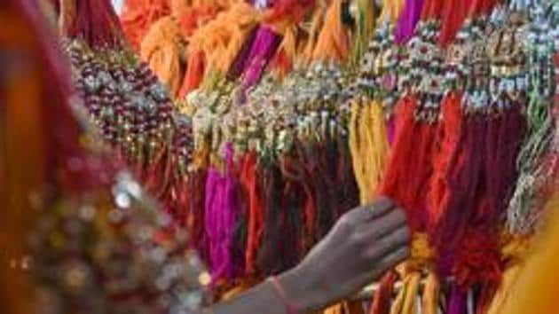 A woman looks at rakhis at a wholesale shop in Mumbai on August 20.(AFP Photo)