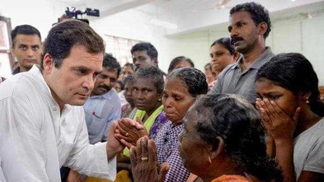 Congress president Rahul Gandhi interacts with the flood-affected people at a relief camp in Chengannur, Alapuzha, Kerala on August 28.(PTI Photo)