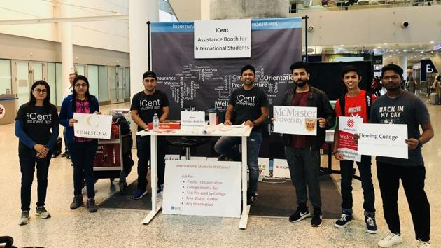 The iCent booth at Toronto's Pearson Aiport. The startup's founder Ganesh Neelanjanmath is seen seated in the middle.(Courtesy iCent)