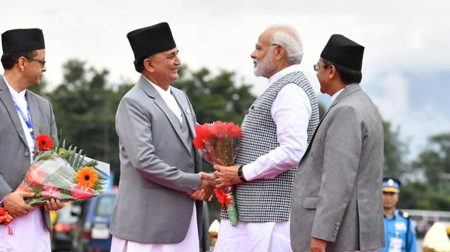 Nepal Deputy Prime Minister and Defence Minister Ishwor Pokhrel received PM Narendra Modi at the Tribhuvan International Airport in Kathmandu.(MEA/Twitter)