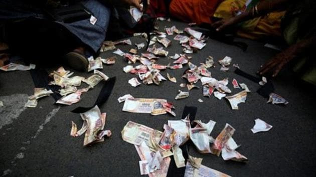 Pieces of old fake 1000 rupee notes lay on the street during a protest, organised by Congress party, to mark a year since demonetisation was implemented by Prime Minister Narendra Modi, in Ahmedabad, India.(REUTERS File Photo)