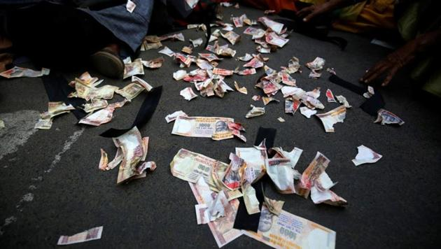 Pieces of old fake 1000 rupee notes lay on the street during a protest, organised by the Congress party, to mark a year since demonetisation was implemented by Prime Minister Narendra Modi.(REUTERS)