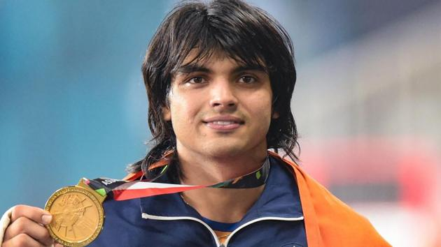 Gold medallist India's Neeraj Chopra poses for photographs at the medal ceremony of the men's javelin throw event during the 18th Asian Games 2018 in Jakarta.(PTI)