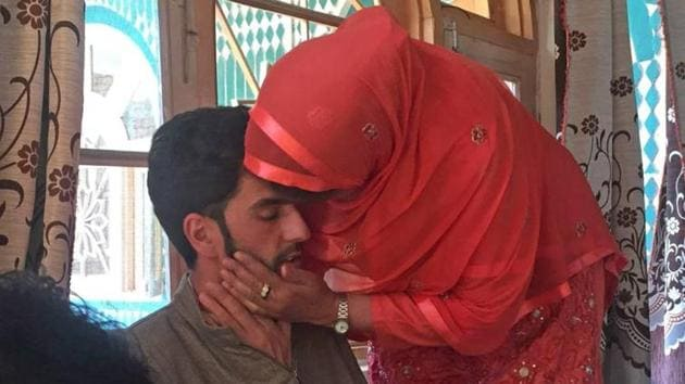 A relative kisses Nisar Ahmad after his release by militants in south Kashmir's Midoora village of Awantipora in Pulwama district of Jammu & Kashmir on Saturday.(Waseem Andrabi/HT Photo)