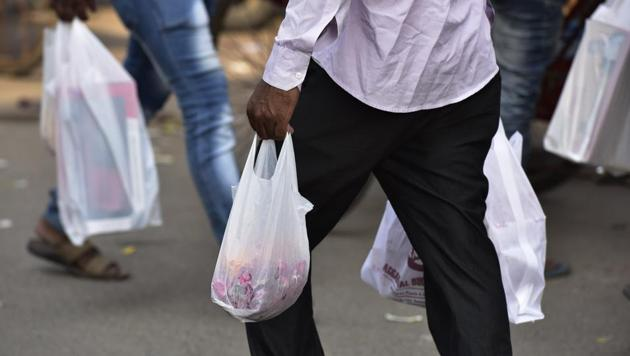 Bags less than 50 microns thick are harder to recycle and separate from trash, and often clog the drains.(Virendra Singh Gosain/HT PHOTO)