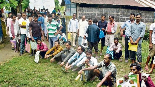 People left out in the NRC draft wait to collect forms to file appeals near a centre in Guwahati. Complaints have been pouring since the final draft did not carry names of four million people on July 30.(AP File Photo)