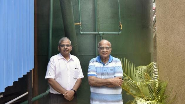 (Left) Nikhil Mehta, executive director of Club Emerald and Jashwant Mehta, the chairman of the club, near the biogas plant at Swastik Park, Chembur on Saturday.(Kunal Patil/HT Photo)