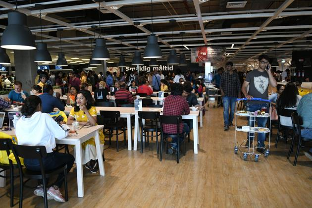 Customers eats at a restaurant at the new IKEA store in Hyderabad.(AFP Photo)
