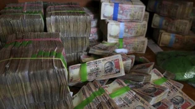 Discontinued Indian currency notes of 1,000 denomination are seen after they were deposited by people at a bank in Bengaluru.(AP File Photo)