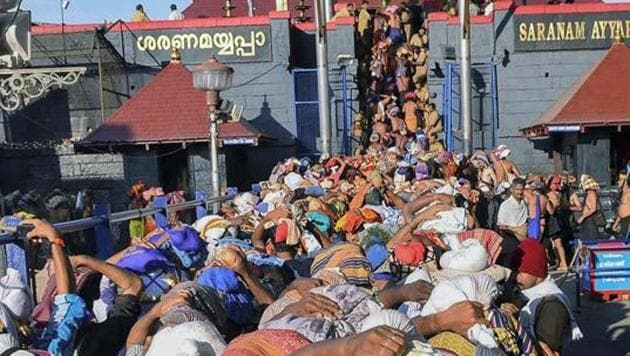 File photo of devotees at Lord Ayyappa temple in Sabarimala.(PTI)