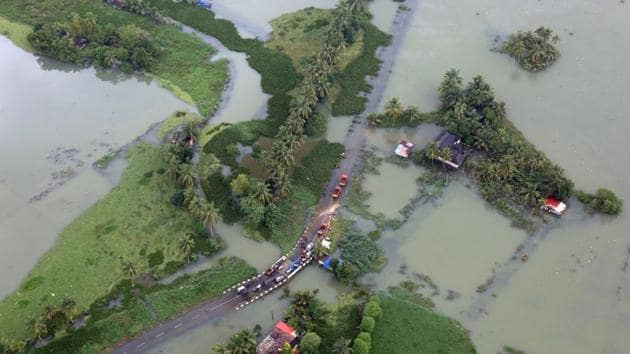 An aerial view shows partially submerged road at a flooded area in the southern state of Kerala on August 19.(REUTERS)
