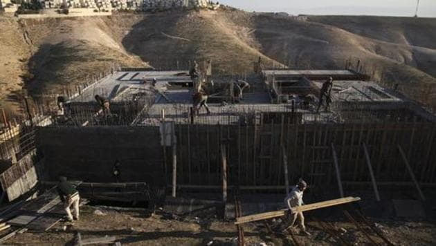 Palestinian laborers work at a construction site in the Israeli settlement of Maale Adumim, near Jerusalem.(AP File Photo)