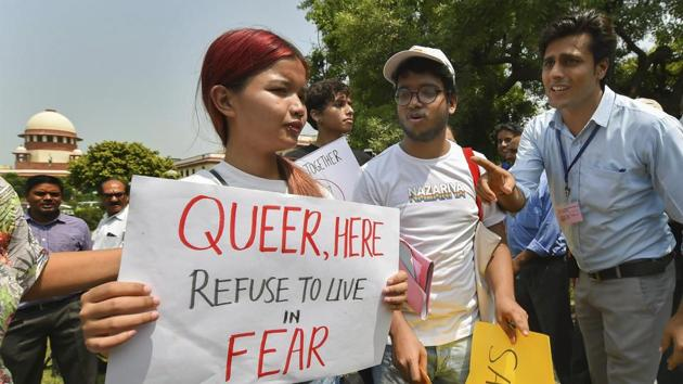 People react after the Supreme Court verdict which decriminalises consensual gay sex, outside the Supreme Court in New Delhi.(PTI Photo)