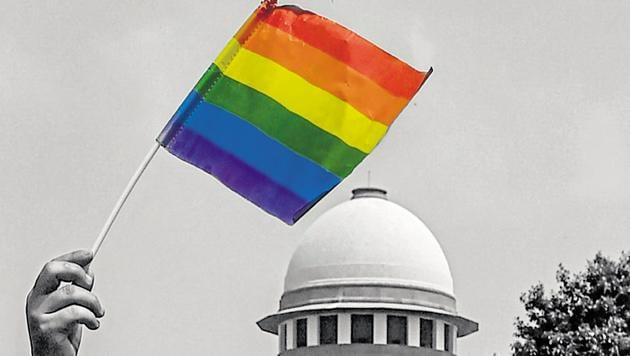 An activist waves a rainbow flag after the Supreme Court verdict which decriminalises consensual gay sex, outside the Supreme Court in New Delhi.(PTI Photo)