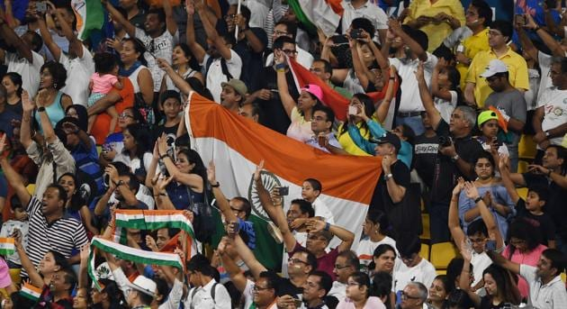 Indian fans celebrate after their team's victory against Pakistan in the men's field hockey bronze medal match between India and Pakistan at the 2018 Asian Games in Jakarta on September 1, 2018. (Photo by AAMIR QURESHI / AFP)(AFP)