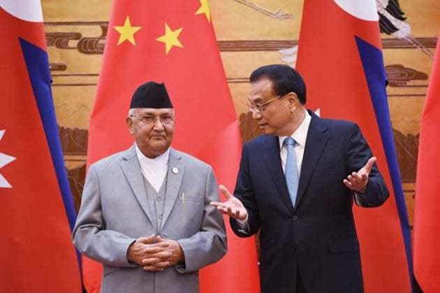 Nepal's Prime Minister KP Sharma Oli (L) chats with Chinese Premier Li Keqiang during a signing ceremony at the Great Hall of the People in Beijing on June 21, 2018.(AFP File Photo)