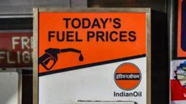 A notice board displays the revised prices of petrol and diesel outside a fuel station, in Mumbai on Tuesday, September 4.(PTI Photo)