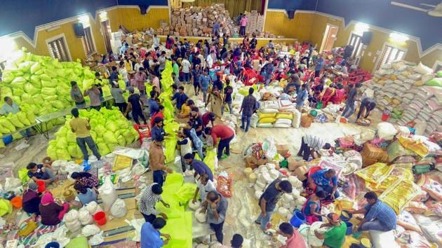Volunteers segregating flood relief material at a distribution centre for Kerala floods, in Kochi on Sunday, September 2, 2018.(PTI Photo)