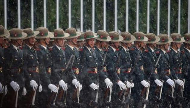 Nepalese Army personnel wait in the rain to present the guard of honour to Sri Lanka's President Maithripala Sirisena before his arrival to attend the Bay of Bengal Initiative for Multi-Sectoral Technical and Economic Cooperation (BIMSTEC) summit in Kathmandu, Nepal August 29, 2018.(REUTERS File Photo)