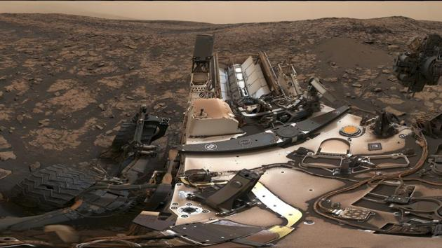 This composite image made available by Nasa shows the Curiosity rover at Vera Rubin Ridge on Mars. A thin layer of dust is visible on the nuclear-powered rover, the result of a storm that enveloped the planet this summer. The darkish sky is from dust still in the atmosphere.(AP File Photo)