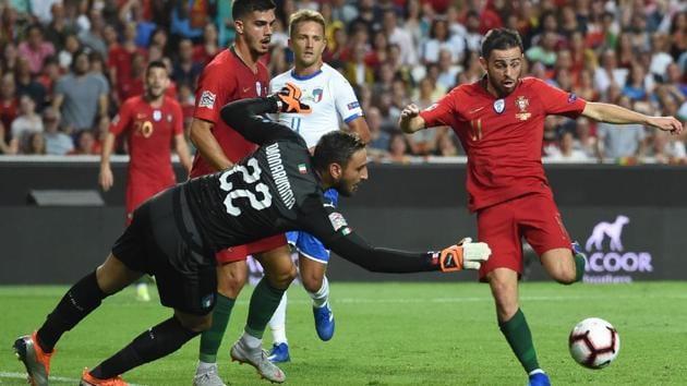 Portuguese forward Bernardo Silva (right) vies with Italian goalkeeper Gianluigi Donnarumma during the UEFA Nations League match at the Luz stadium in Lisbon.(AFP)