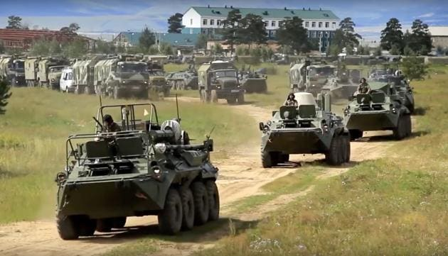 In this frame grab provided by Russian Defense Ministry Press Service on September 11, Russian armoured personnel carriers roll during the military exercises in the Chita region, Eastern Siberia, during the Vostok 2018 exercises in Russia.(AP Photo)