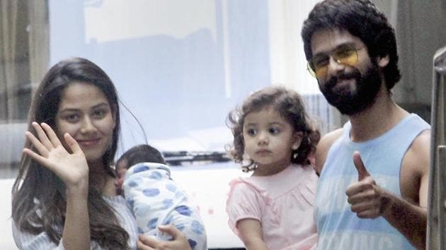 Bollywood actor Shahid Kapoor and his wife Mira Rajput with their newborn son Zain and daughter Misha Kapoor.(PTI)