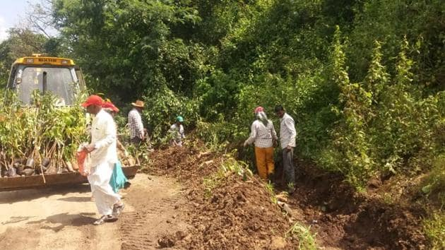NGO Green Thumb will plant saplings to celebrate Ganesh festival. Here, the soil is being prepared for the same.(HT PHOTO)