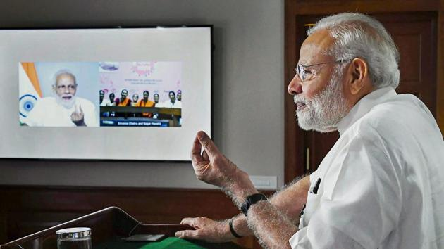 Prime Minister Narendra Modi interacts with the ASHA, Anganwadi and ANM workers from all over the country through video conference, in New Delhi on September 11.(PTI Photo)