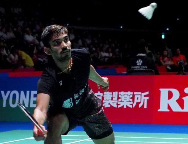 India's Srikanth Kidambi hits a return towards South Korea's Lee Dong-Keun during their men's quarter-final match at the Japan Open badminton championships in Tokyo.(AFP)