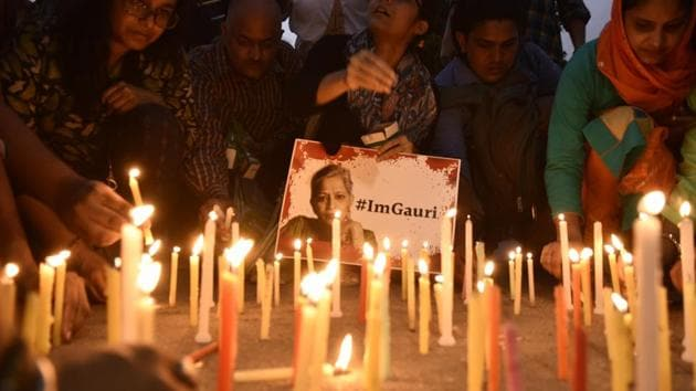 A candlelight vigil organised after the murder of journalist Gauri Lankesh, in New Delhi.(Burhaan Kinu/HT File Photo)